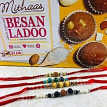 Four Lovely Rakhi Set With Besan Laddu: Rakhi Delivery in Australia