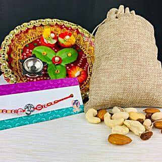 Om Rakhi with Dry Fruits And Traditional Thali: Rakhi and Dryfruits to Australia