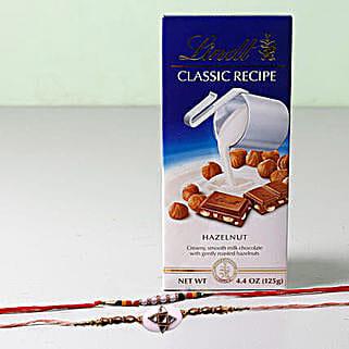 Lindt Classic With Set Of 2 Rakhis: Rakhi With Chocolates To Bahrain