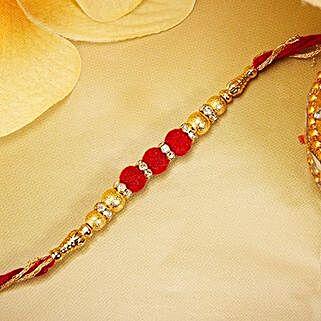 Gold And Red Velvet Beads Rakhi: Send Rakhi to Bhutan