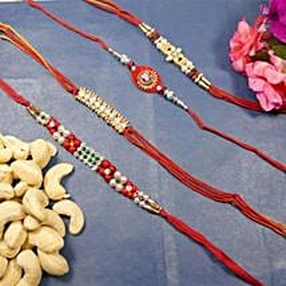 Beautiful Rakhi set of Four With Cashew: Send Rakhi to Canada
