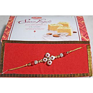 Floral Beads Rakhi N Soan Papdi: Rakhi to Winnipeg