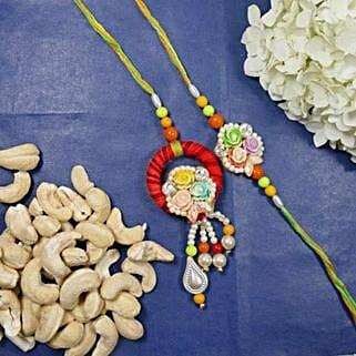 Flowers Bhaiya Bhabhi Rakhi With Cashew: Rakhi for Bhaiya Bhabhi to Canada