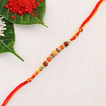 Fancy Orange Red Rakhi Thread: Send Rakhi to Denmark