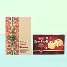 Soan Papdi With Om Rakhi Combo: Rakhi and Sweets to Germany