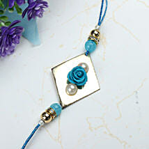 Blue Rose with Pearl Rakhi INDO: Rakhi to indonesia
