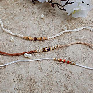 White Thread Rudraksha Diamond Rakhi Set: Rakhi Delivery in Italy