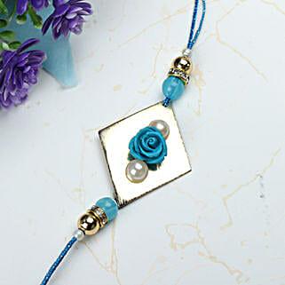 Blue Rose with Pearl Rakhi LEB: Rakhi Delivery in Lebanon