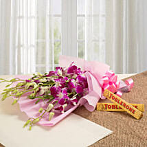 Brighten Their Day Combo: Christmas Flowers & Chocolates
