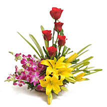 Colourful Blooms Basket Arrangement: Send Anniversary Flowers for Her