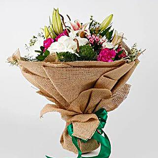 Exotic 32 Mixed Flowers Jute Wrapped Bouquet: Send Flower Bouquets