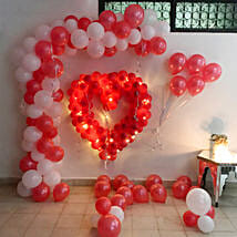 Glowing Red & White Balloon Decor: Birthday Decoration Services