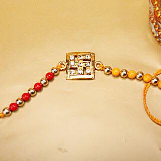 Mesmerizing Swastik Stone Rakhi: Send American Diamond Rakhi