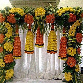 Orange and Yellow Floral Bottle Shape Decoration: Flowers for Janmashtami