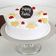 Rakhi and Pineapple Cake: Cake Delivery in Imphal