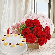 Red Carnations And Pineapple Cake: Flower Delivery in Dhule