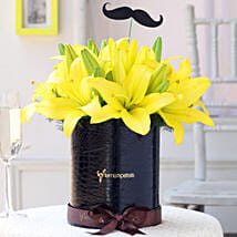 Yellow Lilies Box With Mustache Tag: Flowers for Janmashtami