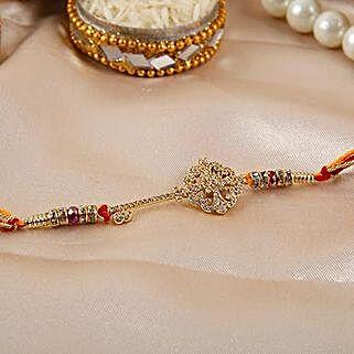 Key Shaped American Diamond Rakhi: Send Rakhi to Mexico