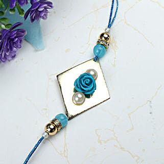 Blue Rose with Pearl Rakhi MOR: Rakhi Delivery in Morocco