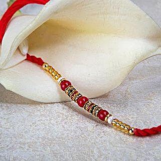 Red And Golden Bead Rakhi: Rakhi Delivery in Nepal
