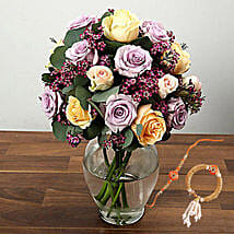 Mixed Rose And Wax Flower Arrangement In Glass Vase With Rakhi: Rakhi Delivery in Singapore