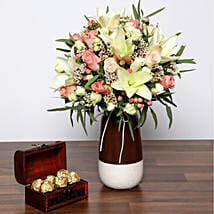 Beautiful White and Peach Flowers In Vase With Rocher: Send Roses to UAE