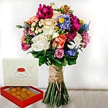 Mesmerizing Flowers and Motichoor Laddoo Combo: Mother's Day Flower and Sweets to UAE