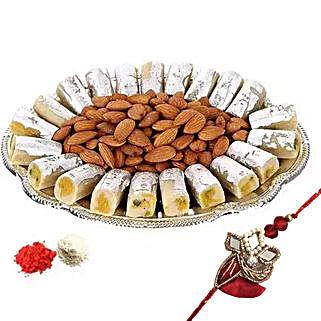 Rakhi with Kaju Roll n Almonds: Rakhi With Dry fruit Hampers