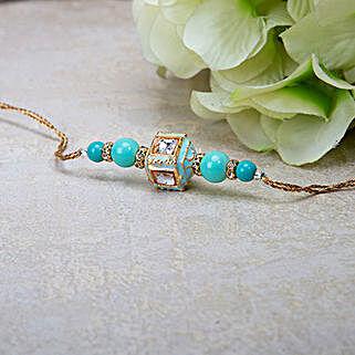 Ravishing Blue Beads Rakhi: Send Rakhi to Abu Dhabi