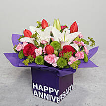 Tulips Roses and Carnations in Glass Vase: Anniversary Gifts to UAE