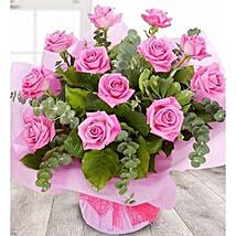 A Dozen Pale Pink Roses: Send Gifts to Manchester, UK