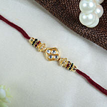Elegant Cream Thread With Diamond Rakhi: Rakhi Delivery in London