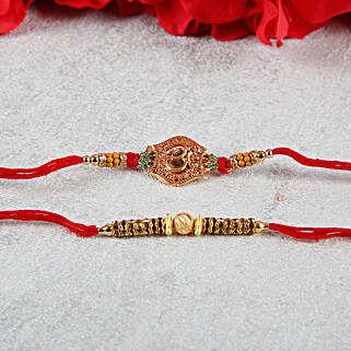 Elegant Designer Aum Golden Rakhi Set: Rakhi for Brother - UK