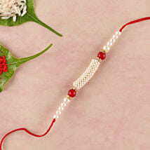 Gorgeous White And Red Beads Rakhi: Send Rakhi to London