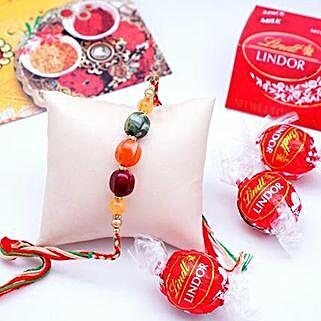 Designer Rakhi with Lindt Milk Truffles Pack: Send Rakhi & Chocolates to USA