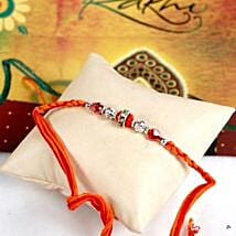 Glittering Maroon Rakhi Thread: Rakhi Delivery in USA