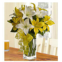 Fresh Love 12 White And Yellow Lilies: Rakhi Delivery in Vietnam