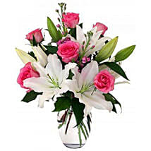 Serene View 12 Lilies And Roses In Vase: Rakhi Delivery in Vietnam